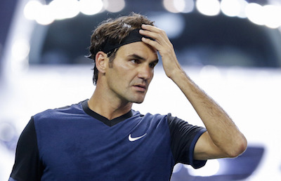 SHANGHAI, CHINA - OCTOBER 13:  Roger Federer of Switzerland reacts after losing the point against Albert Ramos-Vinolas of Spain during their men's singles second round match on day 3 of Shanghai Rolex Masters at Qi Zhong Tennis Centre on October 13, 2015 in Shanghai, China.  (Photo by Lintao Zhang/Getty Images)